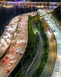 Two types of traffic passing along Han River Seoul South Korea
