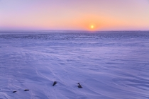 Typical sunset in the frigid -c cold in Canadas Arctic Nunavut