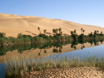 Ubari oasis nestled within the sand dunes of southwestern Libya