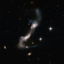 UGC  - a strongly interacting pair of spiral galaxies resembling two ice skaters