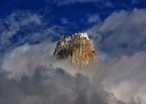 Uli Biaho Tower m rising above the clouds - Part of the Trango Towers in the Baltoro Range  By Sikander Khan