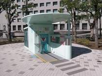 Undeground bicycle parking system in Tokyo Japan You place your bike on the platform and it places it on a rack underground