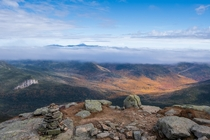 Undercast over fall colors Mt Washington New Hampshire as viewed from Mt Lafayette