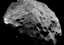 Unlike all of Saturns other moons Phoebe orbits in the opposite direction It is most likely a captured asteroid