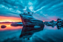 Unreal sunset behind Bonsai Rock Lake Tahoe NV Taken on Christmas day a few years back