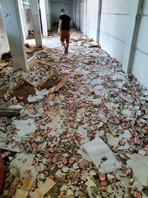 Untouched bootle caps beer labels and invoices full of unsecured customer data on the floor of a brewery closed in  in Brzeg Poland