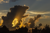 Unusual cloud formation giving upward shining suns rays at sunset - Manorbier South Wales  x  OC