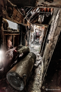 Upstairs hallway of a heavy machinery shop abandoned due to fire damage
