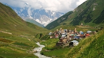 Ushguli village surrounded by Caucasus mountains in Svaneti Georgia