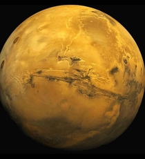 Valles Marineris on Mars is an enormous canyon that stretches wider than the continental US