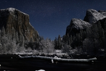 Valley View in Yosemite illuminated by the moon after a winter snow