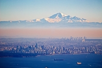 Vancouver BC with Mt Baker Washington looming in the background active volcano