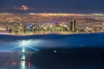 Vancouver Canada A friend of mine thought this picture was a photoshop creation or something like that Its not Its actually just a trick of the fog making it look like two photos put together Its just lucky or perhaps I should say patient timing writes Ma