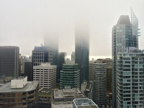 Vancouver Canadas tallest towers disappearing into the clouds