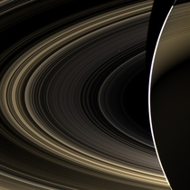 Venus shines like a bright beacon through the rings of Saturn in this unique image taken by the international Cassini spacecraft November