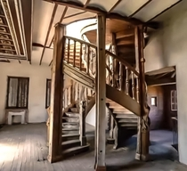 Very cool double spiral staircase in an abandoned house
