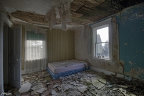 Very Decayed Bedroom Inside an Abandoned House in Rural Ontario