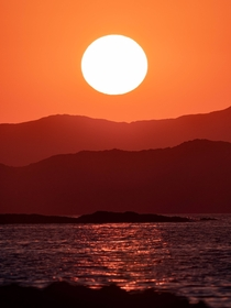 Vibrant sunset in Crete through a telescope