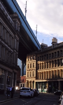 Victorian buildings and streets under the Tyne Bridge in Newcastle