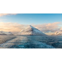 View from a boat of snow covered mountains - Faroe Islands
