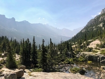 View from Black Lake looking down Glacier Gorge with haze from wildfires Rocky Mountain National Park Colorado USA
