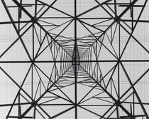 View from directly beneath an electrical transmission tower