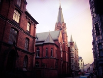 View from down the street of Jesu Hjerte Kirke Sacred Heart of Jesus Catholic Church in Copenhagen Denmark