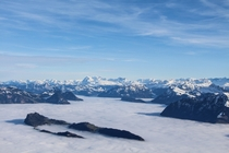 View from Mount Pilatus Switzerland with Lucerne blanketed in fog