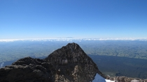 View from Mt Taranaki summit with Mt Ruapehu in the background New Zealand