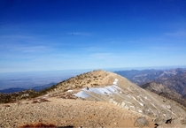View from the top of mount baldy Incredible theres still show on the peak in early May Taken with iPhone