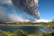 View of Copahue volcano spewing ash behind the lagoon of Caviahue Neuquen province Argentina some  km southwest of Buenos Aires on December