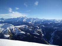View of Mont Blanc mountain range with less snow than usual from La Balme peak m at La Clusaz ski resort French Alps