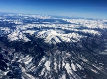 View of mountains in Colorado from an airplane  x