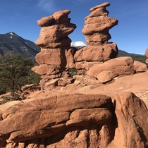 View of Pikes Peak Colorado through the Siamese Twins at the Garden of the Gods park in Colorado Springs Colorado October