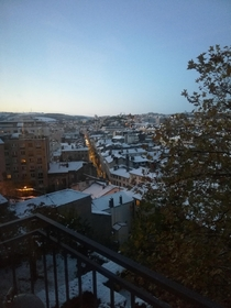 View of Saint-tienne France from my balcony sunset light and snow under the clear sky