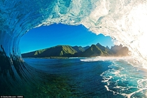 View of Tahiti from inside a wave during a morning surfing session