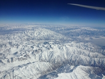 View of the Himalayas in Afghanistan while flying to New Delhi shot with cell phone