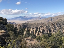 View of the hoodoos and mountains from Heart of Rocks Loop in Chiricahua National Monument Arizona