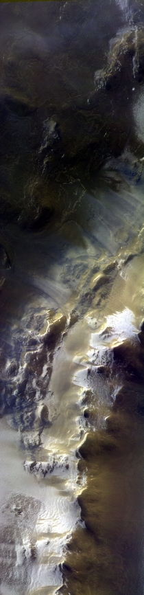 View of the rim of Korolev crater captured by ESAs ExoMars on  April  The image is a composite of three images in different colours that were taken almost simultaneously They were then assembled to produce this colour view