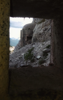View out of an abandoned bunker of the Vallo Alpino fortification line in the alps
