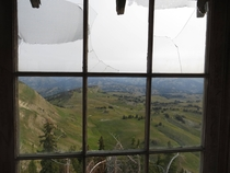 View out of an abandoned fire lookout on Deadman Mountain in Wyoming