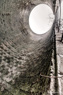 View up from the inside of an abandoned stone grain silo