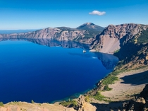 Views of Crater Lake from the Garfield Peak hike The phantom ship rock in the water is ft tall to add perspective
