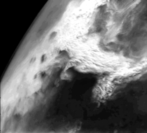 Viking  Orbiter image that shows a large dust storm over the Thaumasia region on Mars This large disturbance soon grew into the first global dust storm observed by the Viking Orbiters