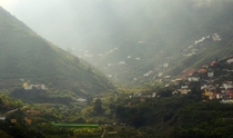 Village in a lush misty valley Gran Canaria Spain