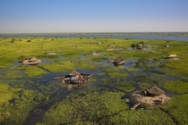 Village in the swamps of the White Nile South Sudan  Photo by Yann Arthus Bertrand