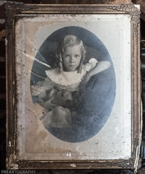 Vintage portrait of a little girl I found in the attic of an abandoned house OC