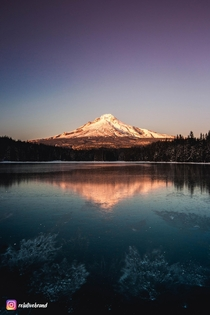 Visited Mt Hood for the first time but I had no idea they closed the road I hiked two miles in the snow to catch sunset at Trillium Lake