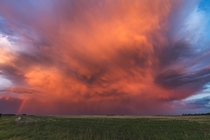 Vivid colours of sunset hitting a storm cell on the Saskatchewan prairie