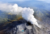 Volcanic gases and ash billow from the peak crater of Mount Ontake in central Japan  Photo by Kyodo News via AP